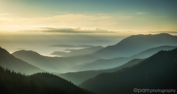 Sunrise over foggy mountains