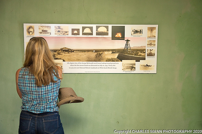 The TrinityTest Site, where the first atomic bomb was exploded on July 16, 1945, is open to the public on the first Saturday of April and October. A visitor reads one of the information signs inthe McDonald Farmhouse.
