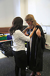 Graduating student being dressed in gown, Goldsmiths College, University of London, England, UK