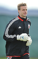 Goalkeeper Andrew Dykstra (50) of D.C. United warming up during the pre-season practice at the auxiliary fields at RFK Stadium, Thursday February 28, 2013.