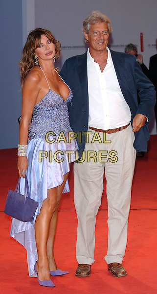 "ALBA PARIETTI & GIUSEPPE LANZA DI SCALIA.Arrivals at screening of ""Casanova"".62nd International Film Festival,.Venice, 3rd September 2005.full length La Biennale purple mauve sparkly diamante strappy short dress shoes bracelet legs purse handbag white shirt blue jacket cleavage.Ref: PL.www.capitalpictures.com.sales@capitalpictures.com.©Capital Pictures."