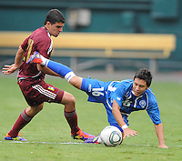 El Salvador midfielder Jaime Alas (16) gets fouled by Venezuela defender Alexander Gonzalez (21). El Salvador National Team defeated Venezuela 3-2 in an international friendly at RFK Stadium, Sunday August 7, 2011.