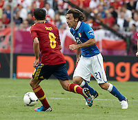 10.06.2012. Gdansk, Polonia. Eurocopa 2012. Pirlo (R) and Xavi Hernandez (L) in action during match between Spain against Italy in Gdsnk Arena
