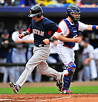 11 March 2010: Boston Red Sox second baseman Dustin Pedroia comes home to score during a Spring Training game against the New York Mets at Tradition Field in Port St. Lucie, Florida. The Red Sox defeated the Mets 8-2 in Grapefruit League action. Mandatory Credit: Ed Wolfstein Photo