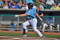 Tennessee Smokies catcher Charlie Cutler #37 swings at a pitch during a game against the Birmingham Barons at Smokies Park on May 31, 2014 in Kodak, Tennessee. The Barons defeated the Smokies 2-1. (Tony Farlow/Four Seam Images)