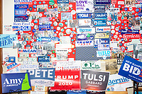 Campaign signs and stickers signed by current and former presidential candidates going back decades are seen in the First in the Nation Primary display at the Visitors Center at the NH State House in Concord, New Hampshire, on Wed., November 13, 2019.