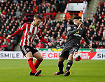 Oliver Norwood of Sheffield Utd passes past Emi Buendia of Norwich City during the Premier League match at Bramall Lane, Sheffield. Picture date: 7th March 2020. Picture credit should read: Simon Bellis/Sportimage