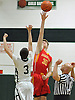 Kyle Murphy #30 of Chaminade and Thornton Scott #3 of Holy Trinity, right, go up for the opening tipoff of a CHSAA varsity boys' basketball game at Holy Trinity High School on Tuesday, Feb. 2, 2016.