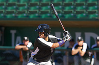 Omar Carrizales (8) of the Grand Junction Rockies at bat against the Ogden Raptors on June 19, 2014 at Lindquist Field in Ogden, Utah. (Stephen Smith/Four Seam Images)