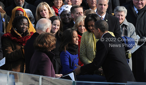 Washington, DC - January 20, 2009 -- United States President President Barack Obama goes to his family after giving his inaugural address after being sworn in as the 44th President of the United States in Washington, DC, USA 20 January 2009. Obama defeated Republican candidate John McCain on Election Day 04 November 2008 to become the next U.S. President.Credit: Pat Benic - Pool via CNP