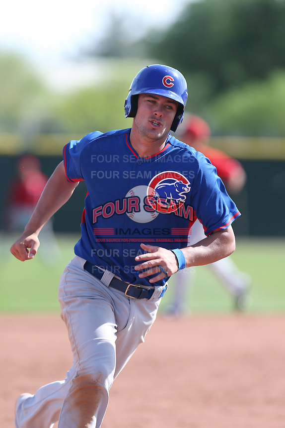Kris Bryant of the Chicago Cubs runs the bases during a Minor League Spring Training Game against the Los Angeles Angels at the Los Angeles Angels Spring Training Complex on March 23, 2014 in Tempe, Arizona. (Larry Goren/Four Seam Images)