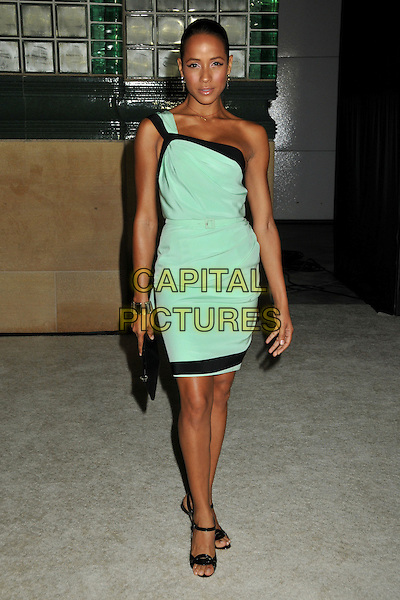 "DANIA RAMIREZ.""Vanity Fair Portraits: Photographs 1913?2008"" Exhibition at the LA County Museum of Art, Los Angeles, California, USA..October 21st, 2008.full length black trim one shoulder green dress clutch bag .CAP/ADM/BP.©Byron Purvis/AdMedia/Capital Pictures."