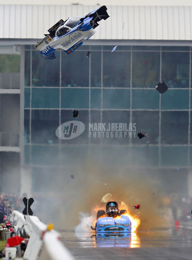 Mar 16, 2019; Gainesville, FL, USA; NHRA funny car driver Tommy Johnson Jr explodes the body off his car during qualifying for the Gatornationals at Gainesville Raceway. Johnson was uninjured in the explosion. Mandatory Credit: Mark J. Rebilas-USA TODAY Sports