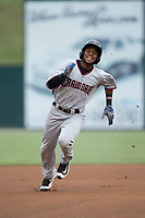 Franklin Rollin (40) of the Hickory Crawdads hustles towards third base after hitting a triple to lead off the top of the first inning against the Kannapolis Intimidators at Kannapolis Intimidators Stadium on April 22, 2017 in Kannapolis, North Carolina.  The Intimidators defeated the Crawdads 10-9 in 12 innings.  (Brian Westerholt/Four Seam Images)