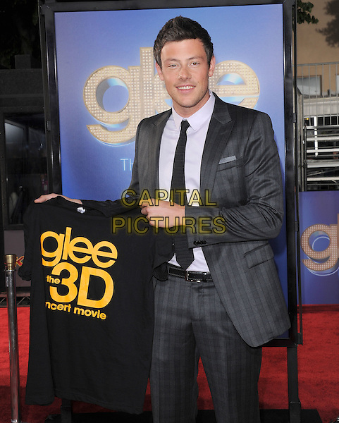 Cory Monteith .attends The 20th Century Fox 'Glee 3D' Concert World Movie Premiere held at The Regency Village theatre in Westwood, California, USA, .August 6th 2011..half length holding logo t-shirt suit grey gray black tie .CAP/RKE/DVS.©DVS/RockinExposures/Capital Pictures.