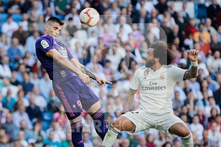 Real Madrid's Marcelo Vieira and Real Club Celta de Vigo's Maxi Gomez during La Liga match between Real Madrid and Real Club Celta de Vigo at Santiago Bernabeu Stadium in Madrid, Spain. March 16, 2019. (ALTERPHOTOS/A. Perez Meca)