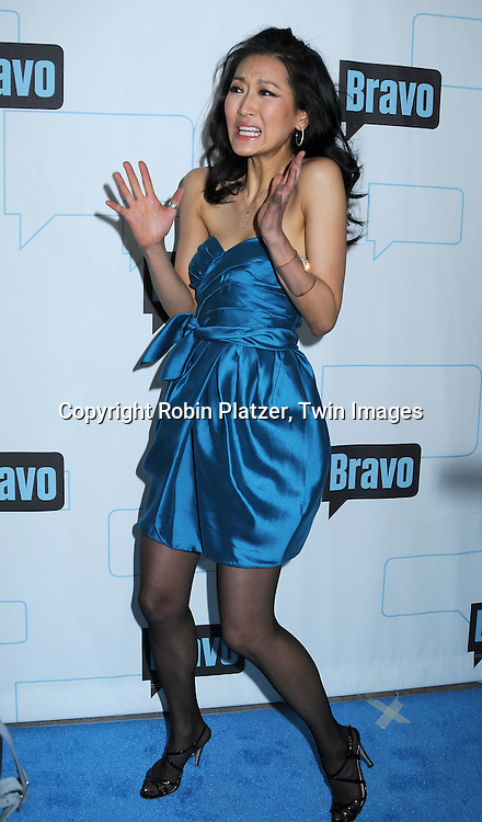 """Kelly Choi of """"Top Chef Masters"""" posing for photographers at The Bravo Upfront  Party on March 10, 2010 at Skylight Studios in New York City."""
