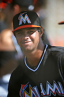 GCL Marlins pitcher Leurys De La Rosa (26) in the dugout during the first game of a doubleheader against the GCL Mets on July 24, 2015 at the St. Lucie Sports Complex in St. Lucie, Florida.  GCL Marlins defeated the GCL Mets 5-4.  (Mike Janes/Four Seam Images)