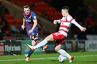 Tony McMahon of Bradford City passes in field away from Tommy Rowe of Doncaster Rovers during the Sky Bet League 1 match between Doncaster Rovers and Bradford City at the Keepmoat Stadium, Doncaster, England on 19 March 2018. Photo by Thomas Gadd.