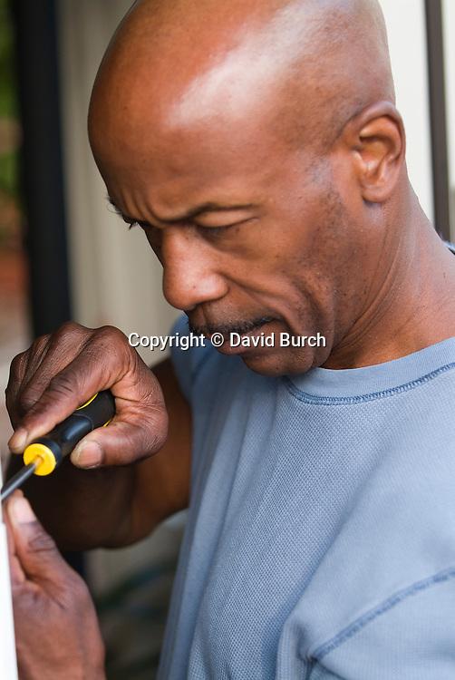 Man using screwdriver, close-up
