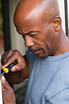 Man using screwdriver, close-up