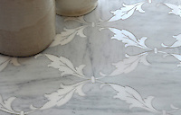 Tamara, a stone waterjet mosaic shown in Carrara and Thassos, is part of the Silk Road Collection by Sara Baldwin for New Ravenna Mosaics.