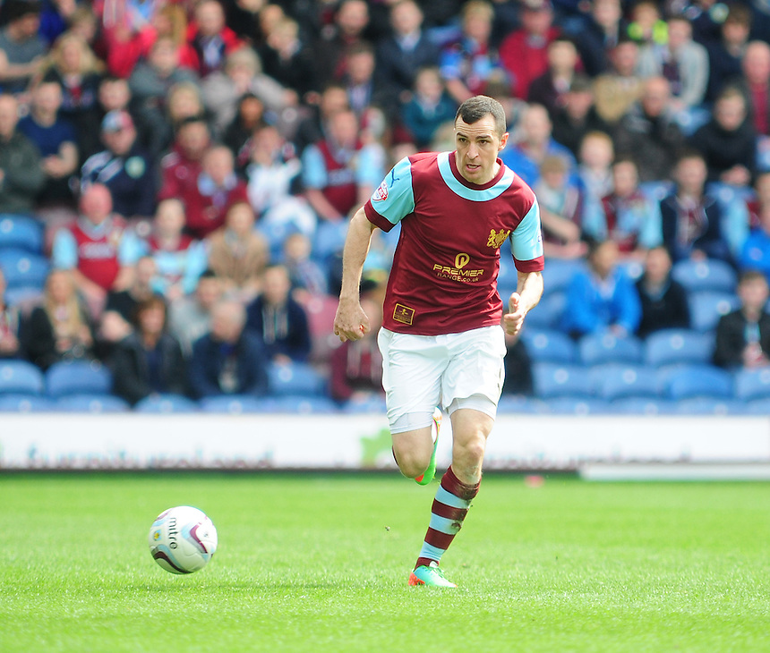 Burnley's Dean Marney <br /> <br /> Photo by Chris Vaughan/CameraSport<br /> <br /> Football - The Football League Sky Bet Championship - Burnley v Ipswich Town - Saturday 26th April 2014 - Turf Moor - Burnley<br /> <br /> &copy; CameraSport - 43 Linden Ave. Countesthorpe. Leicester. England. LE8 5PG - Tel: +44 (0) 116 277 4147 - admin@camerasport.com - www.camerasport.com
