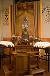 San Juan Bautista, CA<br /> Old Mission San Juan Bautista (1797), interior detail with statues and devotional candles