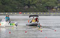 Rio de Janeiro. BRAZIL.  KAZ M1X, Vladislav YAKOVLEV, capsizes, during the heats, and manages to get himself back in the boat, to finish the course.  <br /> 2016 Olympic Rowing Regatta. Lagoa Stadium,<br /> Copacabana,  &ldquo;Olympic Summer Games&rdquo;<br /> Rodrigo de Freitas Lagoon, Lagoa.   Monday  08/08/2016 <br /> <br /> [Mandatory Credit; Peter SPURRIER/Intersport Images]