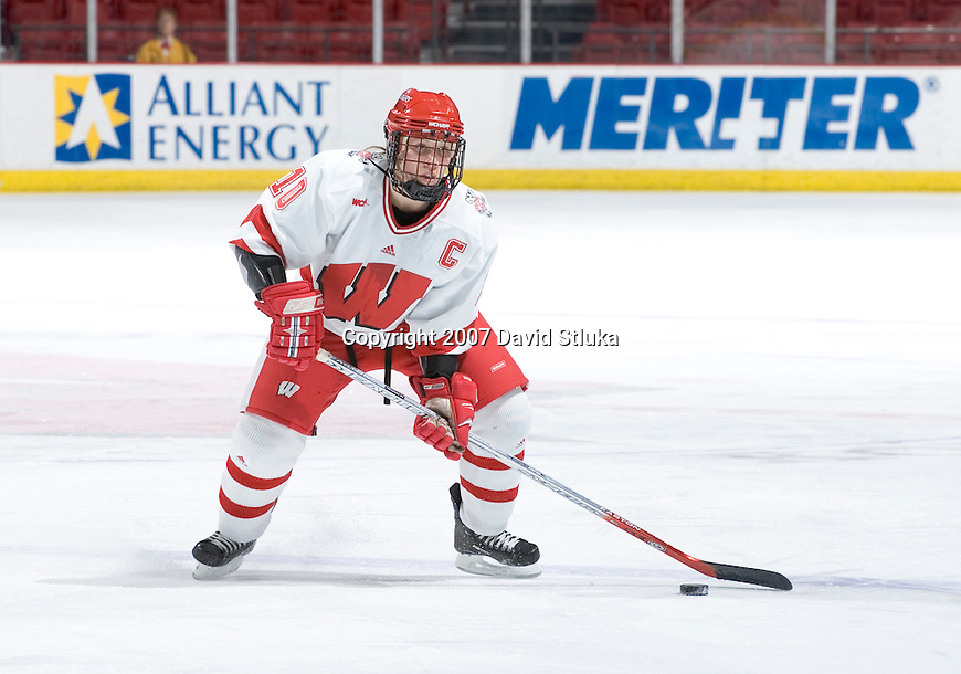 MADISON, WI - FEBRUARY 16: Bobbi Jo-Slusar #10 of the Wisconsin Badgers women's hockey team handles the puck against the Bemidji State Beavers at the Kohl Center on February 16, 2007 in Madison, Wisconsin. The Badgers beat the Beavers 2-0. (Photo by David Stluka)