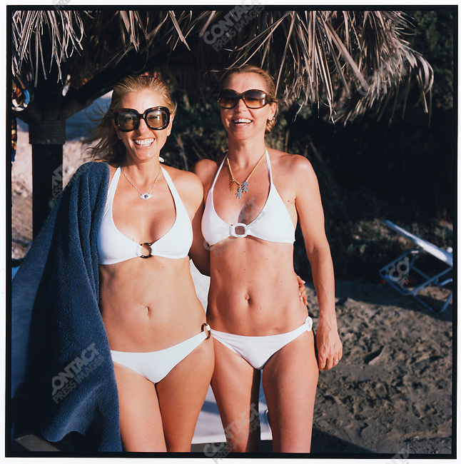 Princess Marie-Chantal, wife of Prince Pavlos, the Crown Prince of Greece, photographed with her friend Carine Mavroleon on a private beach during the Princess's family vacation in Porto Heli. Greece, August 2007.