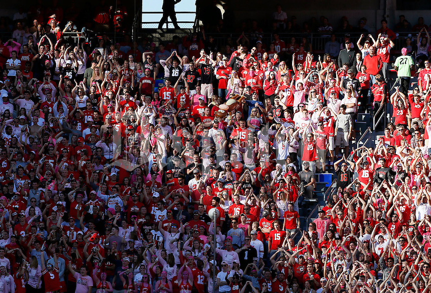 Half in shade, Ohio State students cheer on the Buckeyes during the second quarter of the NCAA football game against the Indiana Hoosiers at Ohio Stadium in Columbus on Oct. 8, 2016. (Adam Cairns / The Columbus Dispatch)