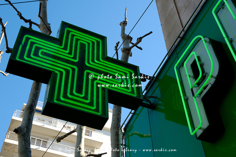 Green neon sign advertising a pharmacy, Marseille, France.