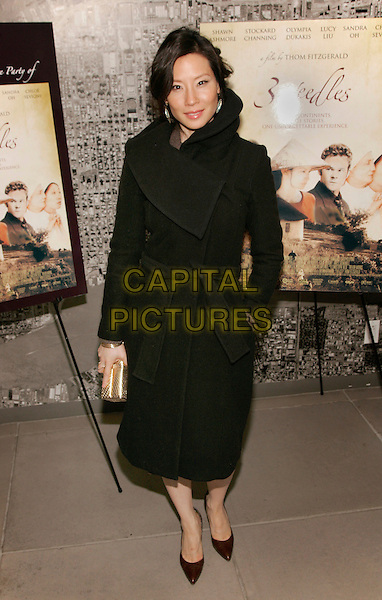 "LUCY LIU.At a special screening of ""3 Needles"" at MOMA, New York, NY, USA..March 18th, 2006.Photo: Jackson Lee/Admedia/Capital Pictures.Ref: JL/ADM.full length black coat gold clutch.www.capitalpictures.com.sales@capitalpictures.com.© Capital Pictures."