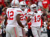 Ohio State Buckeyes cornerback Eli Apple (13) celebrates an interception with teammates safety Tyvis Powell (23) and cornerback Doran Grant (12) during the third quarter of the NCAA football game at Byrd Stadium in College Park, Maryland on Oct. 4, 2014. (Adam Cairns / The Columbus Dispatch)