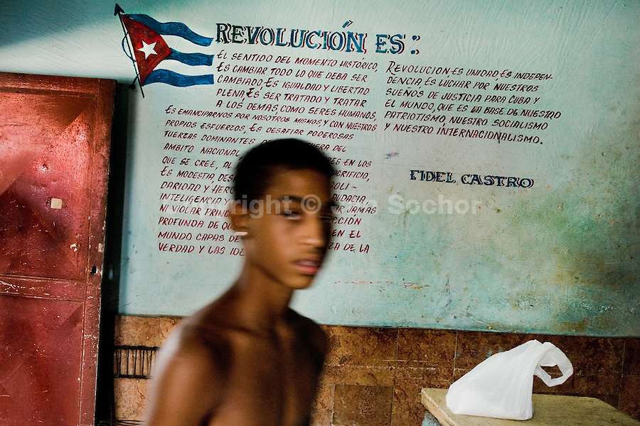 A young Cuban boy passes in front of the famous Fidel Castro's Revolution speech written on the wall in a bakery, Havana, Cuba, 12 August 2008. About 50 years after the national rebellion, led by Fidel Castro, and adopting the communist ideology shortly after the victory, the Caribbean island of Cuba is the only country in Americas having the communist political system. Although the Cuban state-controlled economy has never been developed enough to allow Cubans living in social conditions similar to the US or to Europe, mostly middle-age and older Cubans still support the Castro Brothers' regime and the idea of the Cuban Revolution. Since the 1990s Cuba struggles with chronic economic crisis and mainly young Cubans call for the economic changes.