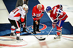 17 October 2009: Montreal Canadiens legendary Captain Henri Richard (center) drops the puck in a ceremonial faceoff between Montreal Canadiens left wing forward Mike Cammalleri and Ottawa Senators right wing forward Daniel Alfredsson prior to a game at the Bell Centre in Montreal, Quebec, Canada. The Senators defeated the Canadiens 3-1. Mandatory Credit: Ed Wolfstein Photo