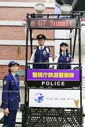Police officers patrol from a stand during a presentation of the security measures in Tokyo Station on May 23, 2016, Tokyo, Japan. Tokyo Metropolitan Police Department has introduced extra security measures ahead of the two-day G-7 leaders summit to be held in Ise-Shima, in Mie Prefecture in Western Japan from May 26. Train and subway stations have also closed their trash cans and added warning signs in their stations. Meanwhile Mie Prefectural Police began restricting entry to Kashikojima Island and the summit area. (Photo by Rodrigo Reyes Marin/AFLO)