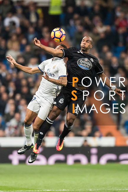 Ryan Guno Babel (r) of RC Deportivo La Coruna competes for the ball with Danielo Luiz Da Silva of Real Madrid during the La Liga match between Real Madrid and RC Deportivo La Coruna at the Santiago Bernabeu Stadium on 10 December 2016 in Madrid, Spain. Photo by Diego Gonzalez Souto / Power Sport Images