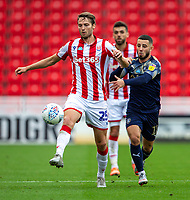 4th July 2020; Bet365 Stadium, Stoke, Staffordshire, England; English Championship Football, Stoke City versus Barnsley; Nick Powell of Stoke City is chased down by Conor Chaplin of Barnsley