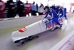 18 December 2010: Alexandr Zubkov pushes his 2-man bobsled for Germany, taking the silver at the Viessmann FIBT World Cup Bobsled Championships on Mount Van Hoevenberg in Lake Placid, New York, USA. Mandatory Credit: Ed Wolfstein Photo