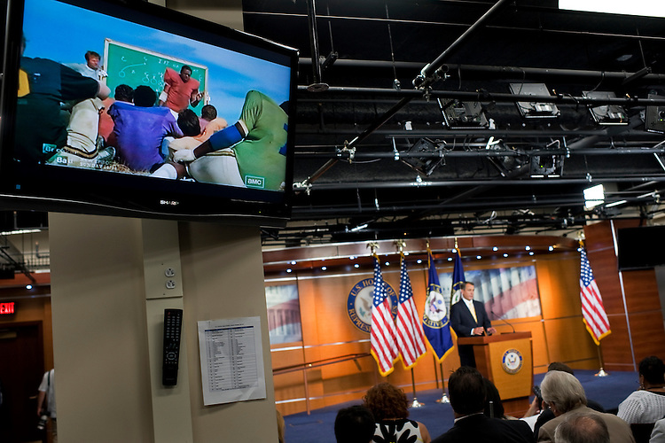 "UNITED STATES - JULY 21:  The movie ""The Longest Yard,"" plays on a television during the weekly news conference of Speaker John Boehner, R-Ohio, in the Capitol Visitor Center where he mainly addressed the debt ceiling talks.  (Photo By Tom Williams/Roll Call)"