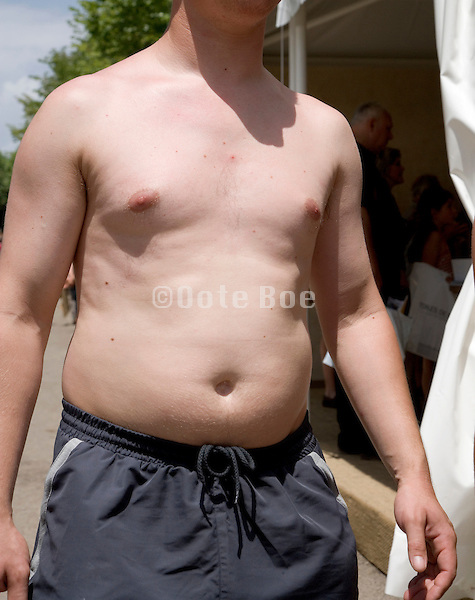 slightly obese torso of an early 30 male person