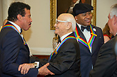 Lionel Richie, left, shares an embrace with Norman Lear, left center, while LL COOL J, center right, converses with United States Secretary of State Rex Tillerson, right, prior to the five recipients of the 40th Annual Kennedy Center Honors posing for a group photo following a dinner hosted by Secretary Tillerson in their honor at the US Department of State in Washington, D.C. on Saturday, December 2, 2017.  The 2017 honorees are: American dancer and choreographer Carmen de Lavallade; Cuban American singer-songwriter and actress Gloria Estefan; American hip hop artist and entertainment icon LL COOL J; American television writer and producer Norman Lear; and American musician and record producer Lionel Richie.  <br /> Credit: Ron Sachs / Pool via CNP