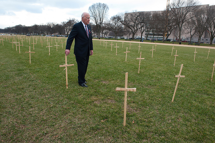 UNITED STATES - Dec 5: Senator Patrick Leahy, D-VT., walks among the crosses that represent the lives lost by individuals attempting to cross the border that are set up outside the tent of the Fast for Families group protesting on the National Mall in Washington, D.C. Leaders and immigrant members of the community will fast every day starting on November 12th, abstaining from all food—except water. The protesters are hoping persuade members of Congress to pass immigration reform with a path to citizenship. (Photo By Douglas Graham/CQ Roll Call)