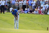 Rory McIlroy (NIR) chips onto the 18th green during Friday's Round 2 of the 2014 Irish Open held at Fota Island Resort, Cork, Ireland. 20th June 2014.<br /> Picture: Eoin Clarke www.golffile.ie