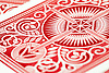 A classic red and white design on the reverse of a playing card, up close.