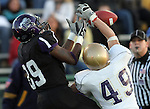 ROME, GA - DECEMBER 18: Michael Hicks #89 of the University of Sioux Falls battles for the ball with Ted Morigeau #49 of Carroll College in the second quarter at Barron Stadium in the 2010 NAIA National Football Championship in Rome, GA.(photo by Dave Eggen/Inertia)