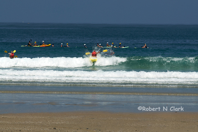 Kayakers getting started at La Jolla Shores, get through that wave