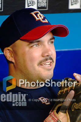 3 April 2006: Nick Johnson, first baseman for the Washington Nationals, sits in the dugout prior to the Opening Day game against the New York Mets at Shea Stadium, in Flushing, New York. The Mets defeated the Nationals 3-2 to lead off the 2006 MLB season...Mandatory Photo Credit: Ed Wolfstein Photo..